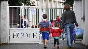 In this file photo taken on September 4, 2017, Pupils arrive at a primary school on the first day of the new school year, in La Rochelle, western France.