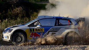 Sebastien Ogier and co-driver Julien Ingrassia steer their Wolkswagen Polo R WCR during the second stage of the 50th Rally of Catalonia on October 24, 2014