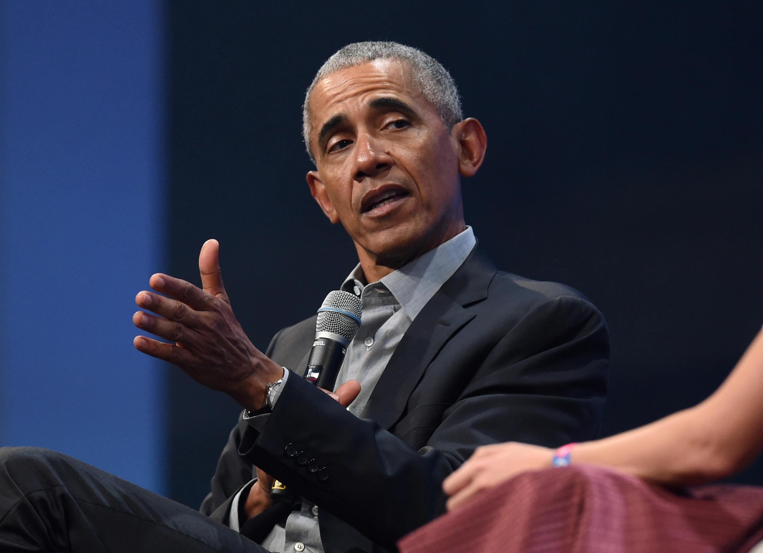 """In this file photo former US President Barack Obama speaks during the """"Bits & Pretzels"""" start-ups and founder congress in Munich, Germany, September 29, 2019,"""