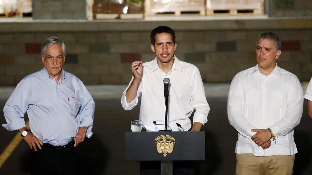 El presidente de Colombia, Iván Duque, el presidente de Chile, Sebastián Piñera, y el líder de la oposición venezolana, Juan Guaidó, se dirigen a la prensa cerca del cruce de Tienditas, en Cúcuta, Colombia, este 22 de febrero de 2019.