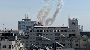 Trails of smoke are seen as rockets are fired from Gaza towards Israel, in Gaza November 14, 2019