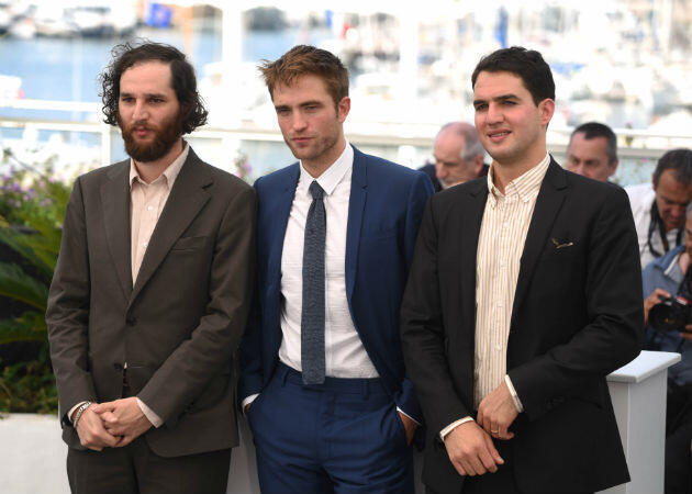 "Robert Pattinson (centre) gets tough and scuzzy in ""Good Time"", by Safdie brothers Josh (left) and Benny."