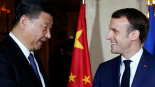French President Emmanuel Macron welcomes Chinese President Xi Jinping as he arrives for a dinner at the Villa Kerylos in Beaulieu-sur-Mer, near Nice, France, on March 24, 2019