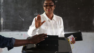 (FILES) In this file photo taken on October 06, 2018 Mayor of Libreville and Gabonese Democratic Party (PDG) candidate for the local elections, Rose Christiane Ossouka Raponda, casts her vote at a polling station in Libreville, during the first round of the country's legislative and municipal elections.