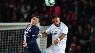 PSG's Marco Verratti and Marseille's Dimitri Payet -- the teams will meet in mid-September, early in the new French season