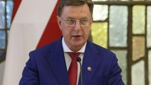 """Latvian Prime Minister Maris Kucinskis, pictured August 2018, vowed to """"adhere to parliament's decision"""" regarding the UN Global Compact for Migration, which his parliament has voted against"""