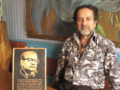 Gonzalo Fuenzalida, poses next to an image of former Chilean president Salvador Allende, 40 years after the left-wing leader was overthrown in a military coup.