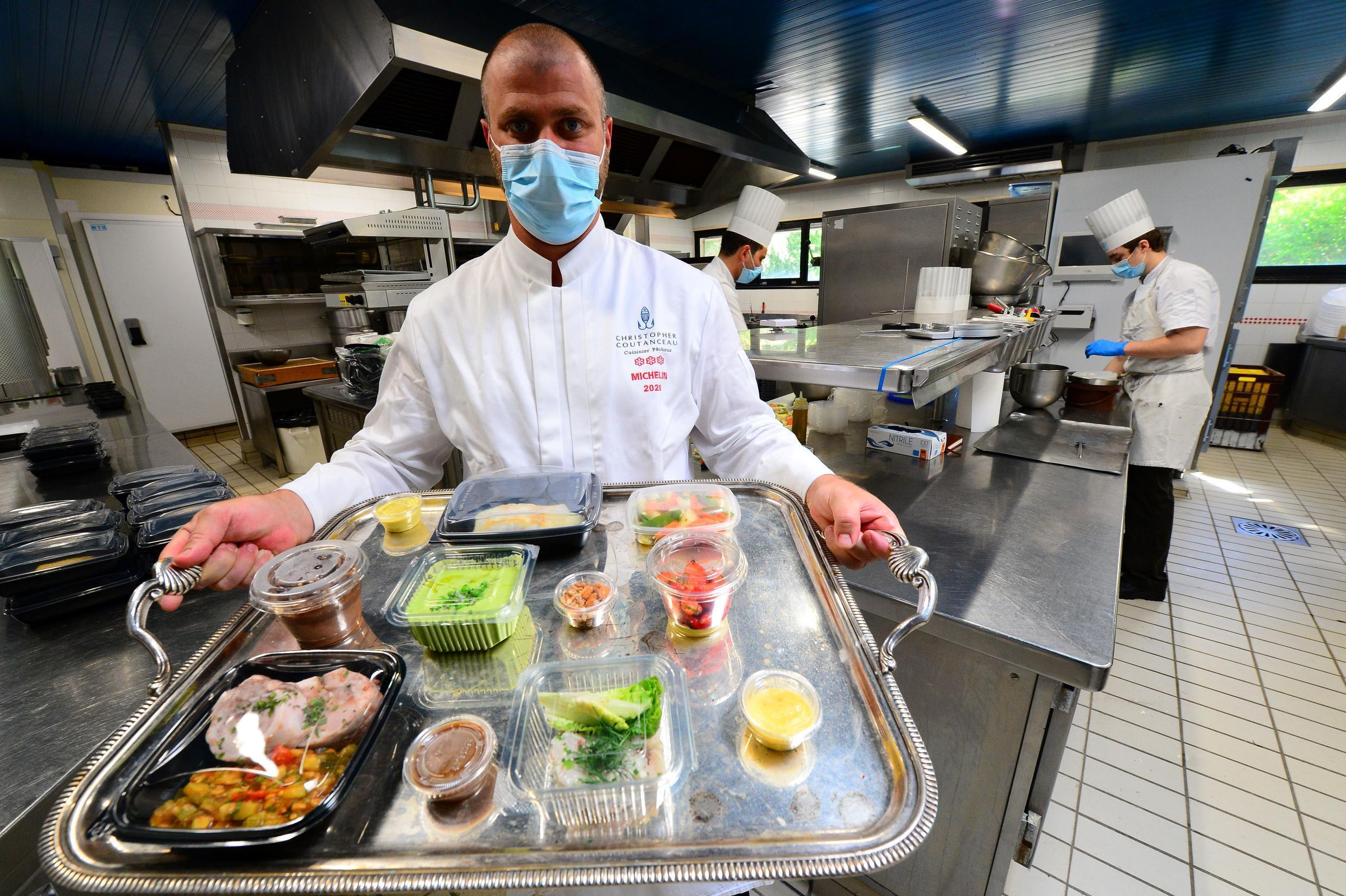 French chef Christopher Coutanceau, who won this year the maximum three Michelin stars, prepares take away meals,on May 6, 2020 at his restaurant in La Rochelle, as the country is under lockdown to stop the spread of the Covid-19 pandemic caused by the novel coronavirus.