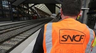 A French SNCF railway worker on strike stands on a platform at Nice railway station on December 6, 2019.
