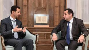 Le président syrien Bachar al-Assad et le député français Jean-Frédéric Poisson,  le 28 octobre 2015.