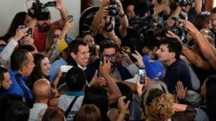 Venezuela's self-proclaimed acting president Juan Guaido leaves a church mass in Caracas