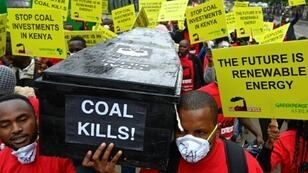 Protesters march in downtown Nairobi to demonstrate against a coal-fired power station planned for Kenya's heritage-listed Lamu archipelago