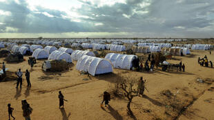 This file photo taken on July 31, 2011 shows Somali refugees walking in the new Ifo-extension at the Dadaab refugee camp in Kenya, the largest refugee camp in the world.