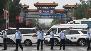 Chinese police guard the entrance to the closed Xinfadi market in Beijing, the centre of the latest virus outbreak, on June 13, 2020.