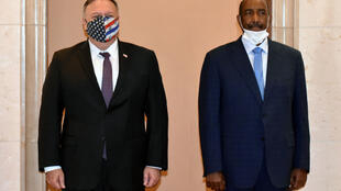 US Secretary of State Mike Pompeo poses for a picture with Sudan's top general Abdel Fattah al-Burhan in Khartoum on an August 2020 visit
