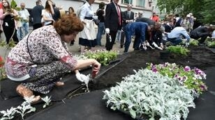 A fierce critic of President Vladimir Putin, Politkovskaya was assassinated on his birthday, with her killing sending shock waves around the world. Here, people planted flowers as a public garden opened in her memory in July