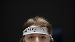 A federal employee wears an evocative headband at a rally on Capitol Hill in Washington for a vote on the shutdown, on January 23, 2019.