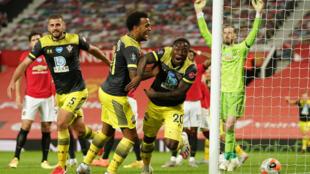 Michael Obafemi (centre) celebrates his late equaliser for Southampton