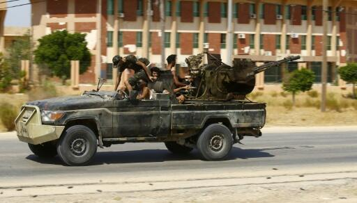 Pro-government forces claim advance south of Libya capital