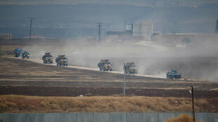 Turkish and Russian military vehicles return following a joint patrol in northeast Syria, as they are pictured from near the Turkish border town of Kiziltepe, November 1 2019.