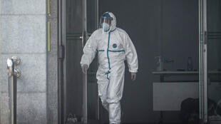 A medical staff member walks outside the Jinyintan hospital, where patients infected by a mysterious SARS-like virus are being treated, in Wuhan in China's central Hubei province on January 18, 2020.
