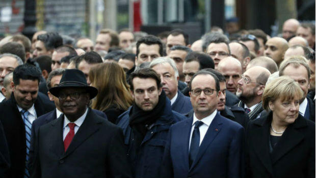 Hollande walks at a march for peace in Paris, flanked by Malian President Ibrahim Boubacar Keita (left) and German Chancellor Angela Merkel (right).