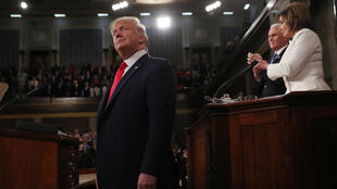 U.S. President Donald Trump arrives as Vice President Mike Pence and Speaker of the House Nancy Pelosi look on prior to delivering his State of the Union address to a joint session of the U.S. Congress in the House Chamber of the U.S. Capitol in Washington, U.S. February 4, 2020.