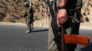 A 2018 file photo shows fighters of the rebel Kurdistan Workers' Party (PKK) manning a roadblock in the Qandil Mountains, the groups's main rear-base in northern Iraq