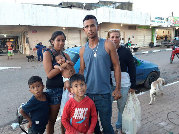 Rojelio and his family before boarding a shared taxi toward their new life.