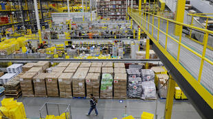 FILE PHOTO: Amazon workers perform their jobs inside of an Amazon fulfillment center on Cyber Monday in Robbinsville, New Jersey, U.S., December 2, 2019.