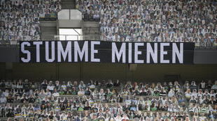 """A banner reading """"Silent Faces"""", surrounded by cardboard cut-out of Borussia Moenchengladbach fans, during Saturday's 3-1 home defeat to Leverkusen."""