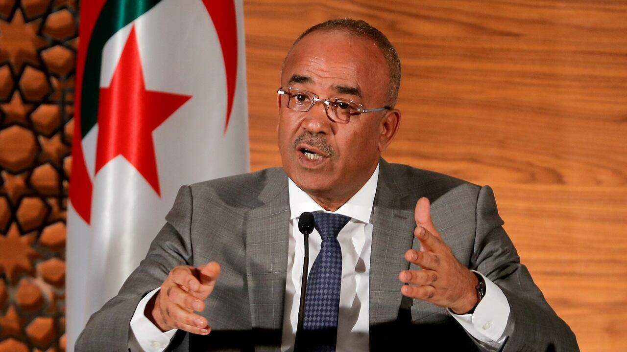 Algerian Prime Minister Noureddine Bedoui speaks during a news conference in Algiers on March 14, 2019.