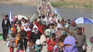 """أبناء الأقلية الإيزيدية تعرضوا لبطش تنظيم """"الدولة الإسلامية"""""""