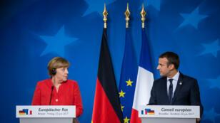 Angela Merkel et Emmanuel Macron lors de la conférence de presse commune à Bruxelles, le 23 juin 2017.