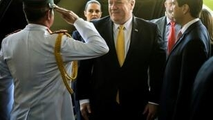 U.S. Secretary of State Mike Pompeo is welcomed by Paraguay's Military Cabinet Chief General Roque Alberto Sotelo (L) and Ambassador Federico Gonzalez (R) at the presidential palace in Asuncion