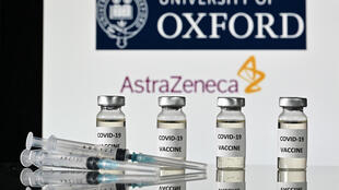 (FILES) This file illustration photo taken on November 17, 2020 shows vials with Covid-19 Vaccine stickers attached and syringes, with the logo of the University of Oxford and its partner British pharmaceutical company AstraZeneca.