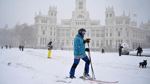 A skier takes advantage of a heavy snowfall in Madrid, Spain on January 9, 2021.