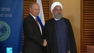 الرئيس الإيراني حسن روحاني ونظيره الروسي فلاديمير بوتين