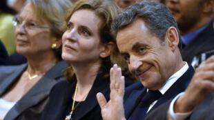 NKM, entourée de Michèle Alliot-Marie et Nicolas Sarkozy lors d'un meeting à Nîmes, le 27 novembre 2014.