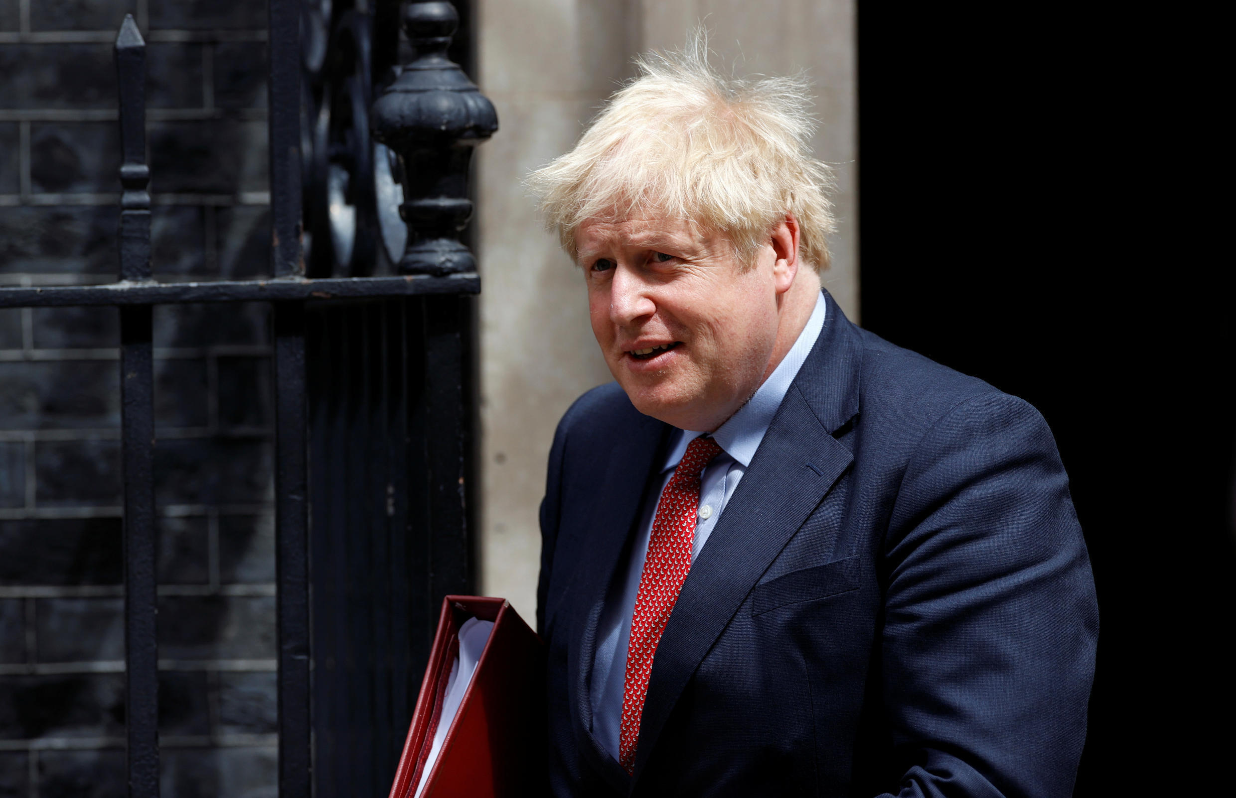 Britain's Prime Minister Boris Johnson leaves Downing Street, in London, Britain on July 15, 2020.