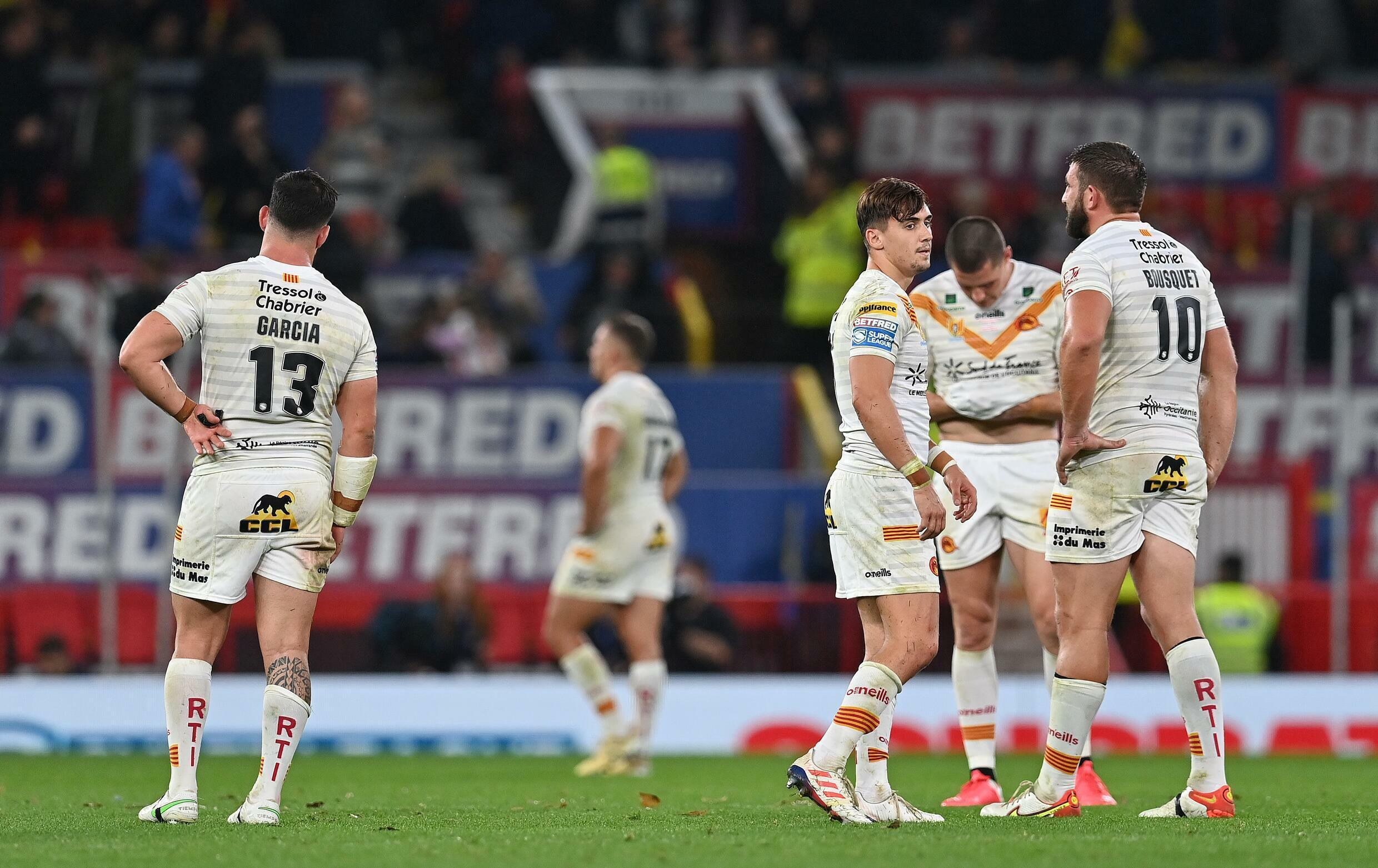 Catalan players despair after losing to St Helens in the Super League final at Old Trafford on October 9, 2021