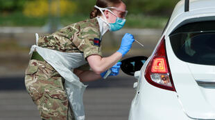 Military personnel are seen testing people at a coronavirus test centre in the car park of Chessington World of Adventures as the spread of the coronavirus disease (COVID-19) continues, Chessington, Britain, April 15, 2020.