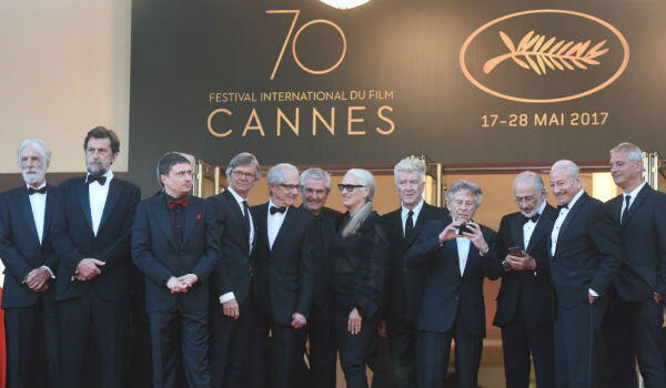 Spot the woman: Jane Campion, the only female director to win a Palme d'Or, pictured with other past laureates at the 70th Cannes Film Festival.