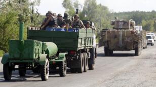Des soldats ukrainiens près de Slaviansk, le 5 août.