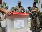 Tunisians cast votes in keenly fought presidential poll
