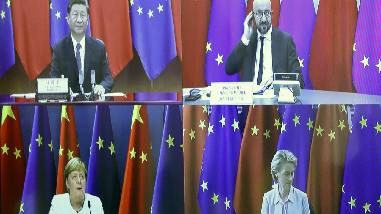 European Council President Charles Michel, top right, speaks with China's President Xi Jinping, top left, European Commission President Ursula von der Leyen, bottom right, and German Chancellor Angela Merkel, bottom left, during a virtual summit on September 14, 2020.