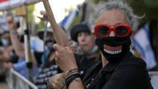 Israeli protesters demonstrate against Prime Minister Benjamin Netanyahu outside his residence in Jerusalem
