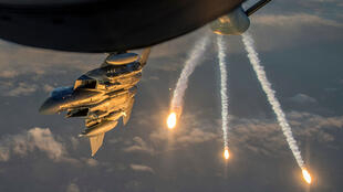 (FILE PHOTO) A U.S. Air Force F-15 Eagle deploys flares above Iraq on March 16, 2018.