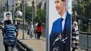 صورة للرئيس السوري بشار الأسد في شارع وسط دمشق في 31 أيار/مايو 2018