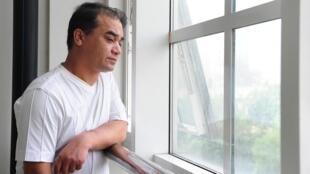 En esta foto de archivo tomada el 12 de junio de 2010, se muestra al profesor universitario, bloguero y miembro de la minoría musulmana uigur, Ilham Tohti.